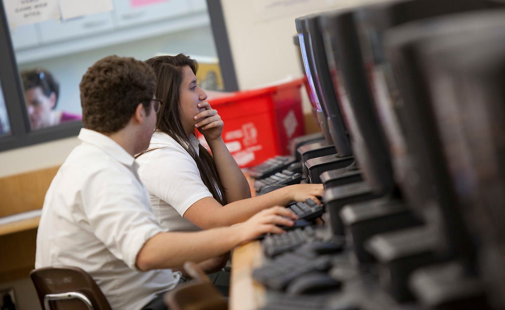 London, Ontario ---11-05-12--- Students Laura Limarzi and Norman Nehmetallah work on the computers in the library at Assumption College Catholic High School in Windsor, Ontario May 12, 2011. The Windsor-Essex Catholic District School board has decided to eliminate school librarians as a cost cutting measure.<br /> GEOFF ROBINS The Globe and Mail