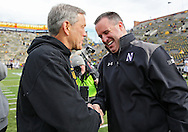 October 26 2013: Iowa Hawkeyes head coach Kirk Ferentz talks with Northwestern Wildcats head coach Pat Fitzgerald before the start of the NCAA football game between the Northwestern Wildcats and the Iowa Hawkeyes at Kinnick Stadium in Iowa City, Iowa on October 26, 2013.