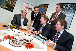 Managaing Director of Barber (DTS) Of Sheffield Ltd Tony Crane ( left) explains the uses of some of the Tattooing equipment supplied by his company   to Investors (from left to right standing)  Andy Dodd and James Dow of PHD and (seated) Wayne Thomas and Paul Betts of EV group..16  May 2012.Image © Paul David Drabble