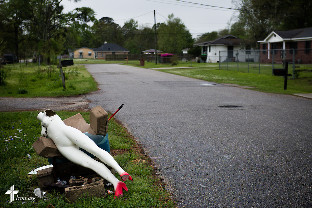 A broken mannequin is left for the trash near Trinity Lutheran Church on Sunday, April 6, 2014, in Mobile, Ala. LCMS Communications/Erik M. Lunsford