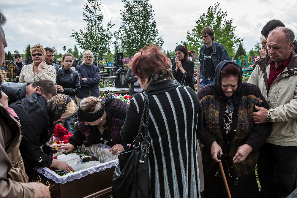 KRAMATORSK, UKRAINE - MAY 5: The funeral of Yulia Izotova, a 21-year-old nurse who was killed in fighting between pro-Russian protesters and the Ukrainian military, on May 5, 2014 in Kramatorsk, Ukraine. Cities across Eastern Ukraine have been overtaken by pro-Russian protesters in recent weeks, leading the Ukrainian military to respond with force in some areas. (Photo by Brendan Hoffman for The Washington Post)
