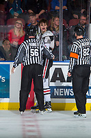 KELOWNA, CANADA - OCTOBER 20: Linesman Cody Wanner escorts Brendan De Jong #21 of the Portland Winterhawks to the penalty box after fighting with the Kelowna Rockets on October 20, 2017 at Prospera Place in Kelowna, British Columbia, Canada.  (Photo by Marissa Baecker/Shoot the Breeze)  *** Local Caption ***