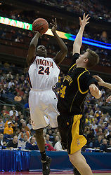 Virginia Cavaliers guard/forward Mamadi Diane (24) shoots over Albany Great Danes center Brent Gifford (54).  The #4 seed Virginia Cavaliers defeated the #13 seed Albany Great Danes 84-57 in the first round of the South Region Men's NCAA Tournament in Columbus, OH on March 16, 2007.