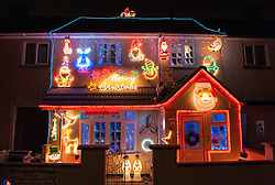 © Licensed to London News Pictures. 01/12/2015. Bristol, UK.  Houses decorated for Christmas in the area near to the Brailsford family's Christmas Lights Big Switch On. Brothers Lee and Paul Brailsford have spent 20 years and more than £20,000 building up their huge collection of festive decorations in Bentry, Bristol to turn the home of their mother Rosemary into a winter wonderland every year. They have tens of thousands of lights, a life-size nativity, trains, snowmen, toy soldiers, reindeers, Santas and a snow machine. They raise money from people who flock to see the spectacle and to date they have raised more than £30,000 for charities such as the Wallace and Gromit Appeal that supports Bristol Children's Hospital.  The electricity and replacement lights cost around £1,000 each year, but this year the brothers are trying to convert everything to LED lights to be more efficient for Bristol's year as European Green capital 2015. Photo credit : Simon Chapman/LNP