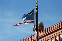 October 8, 2016 - St. Augustine, FL, USA - A tattered U.S. flag flies near Treasury on The Plaza in the wake of Hurricane Matthew in St. Augustine, Fla., on Saturday, Oct. 8, 2016. (Credit Image: © Ricardo Ramirez Buxeda/TNS via ZUMA Wire)