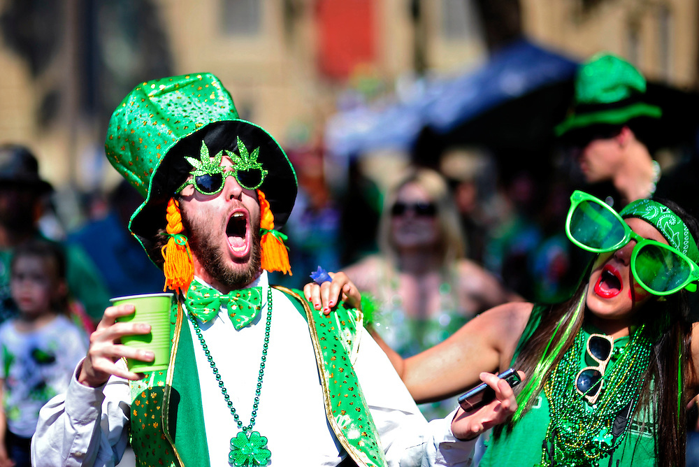 Bart Frederick of Pelham, Alabama, left, and his friend Emma Graham celebrate during the 188th Savannah St. Patrick's Day parade. Savannah boasts the celebration as one of the largest crowds and longest parades in the country.