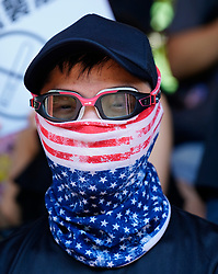 Tuen Mun, Hong Kong. 22 September 2019. Pro democracy demonstration and march through Tuen Mun in Hong Kong. Marchers protesting against harassment by sections of the pro Beijing community. Largely peaceful march had several violent incidents with police using teargas. Several arrests were made. Pictured; Protestor in Mask of USA flag. Iain Masterton Live News.