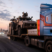 SHEIKHAN, IRAQ - OCTOBER 19: A convoy of U.S. armored military vehicles could be seen leaving Syria on a road into Iraq on October 19, 2019 in Sheikhan, Iraq. (Photo by Byron Smith/Getty Images)