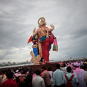 An idol of lord Ganesh taken for immersion in the Indian ocean on the last day of the Ganesh Chaturthi festival. Ganesh, the elephant-headed son of Shiva and Parvati is widely worshiped as the supreme God of wisdom, prosperity and good fortune. Mumbai, September 2009.