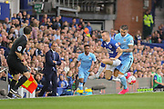 defender Aleksander Kolarov closes midfielder Tom Cleverley during the Barclays Premier League match between Everton and Manchester City at Goodison Park, Liverpool, England on 23 August 2015. Photo by Simon Davies.