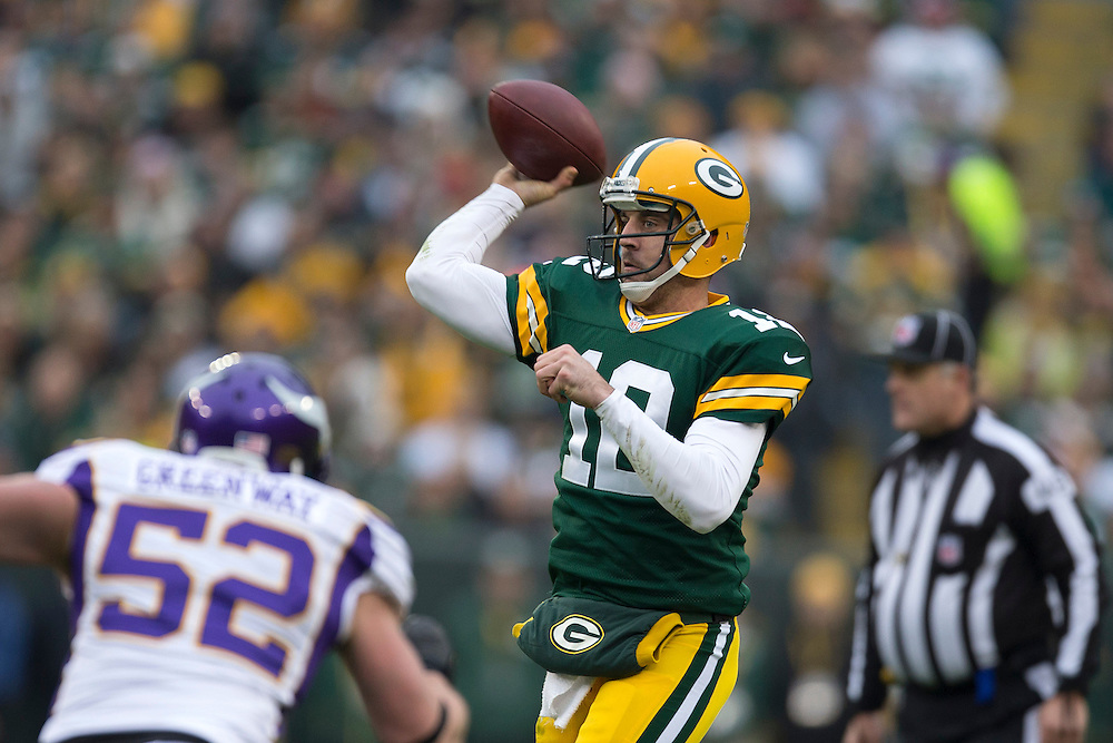 GREEN BAY, WI - DECEMBER 2:  Aaron Rodgers #12 of the Green Bay Packers throws a pass against the Minnesota Vikings at Lambeau Field on December 2, 2012 in Green Bay, Wisconsin.  The Packers defeated the Vikings 23-14.  (Photo by Wesley Hitt/Getty Images) *** Local Caption *** Aaron Rodgers