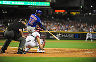 Apr. 29 2011; Phoenix, AZ, USA; Chicago Cubs batter Alfonso Soriano (12) hits a home run during the fifth inning against the Arizona Diamondbacks at Chase Field. Mandatory Credit: Jennifer Stewart-US PRESSWIRE..