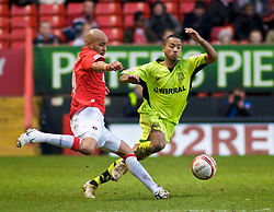 LONDON, ENGLAND - Saturday, January 30, 2010: Charlton Athletic's Leon McKenzie and Tranmere Rovers' Shaleum Logan in action during the Football League One match at the Valley. (Photo by Gareth Davies/Propaganda)