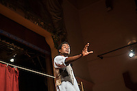 SLIEMA, MALTA - 8 FEBRUARY 2016: Actor Ladi Emeruwa, in the role of Hamlet, performs the touring Hamlet on stage here at the Salesian Theatre in Sliema, Malta, on February 8th 2016.<br /> <br /> The touring Hamlet, performed by the Shakespeare's Globe theatre company, is part of the Globe to Globe tour that set off in April 2014 (on the 450th anniversary of Shakespeare's birth) with the ambitious intention of visiting every country in the world over 2 years. The crew is composed of a total of sixteen men and women: four stage managers and twelve twelve actors  actors perform over two dozen parts on a stripped-down wooden stage. So far Hamlet has been performed in over 150 countries, to more than 100,000 people and travelled over 150,000 miles. The tour was granted UNESCO patronage for its engagement with local communities and its promotion of cultural education. Hamlet was also played for many dsiplaced people around the world. It was performed in the Zaatari camp on the border between Syria and Jordan, for Central African Republic refugees in Cameroon, and for Yemeni people in Djibouti. On February 3rd it was performed to about 300 refugees in Calais at the camp known as the Jungle.