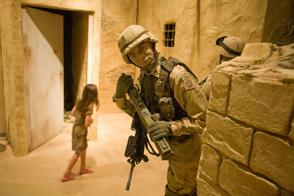 Jillian Gee wanders through an exhibit depicting United States Army soldiers fighting on the streets of Baghdad, Iraq, inside the Airborne & Special Operations Museum in Fayetteville, NC, Sat., Nov. 15, 2008. Gee?s father, Ken, is on active duty with the 82nd Airborne and has been deployed to Iraq and Afghanistan for three tours. .