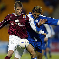 St Johnstone v Arbroath..  09.11.02<br />Paul Hartley and Jordan Tait tangle<br /><br />Pic by Graeme Hart<br />Copyright Perthshire Picture Agency<br />Tel: 01738 623350 / 07990 594431
