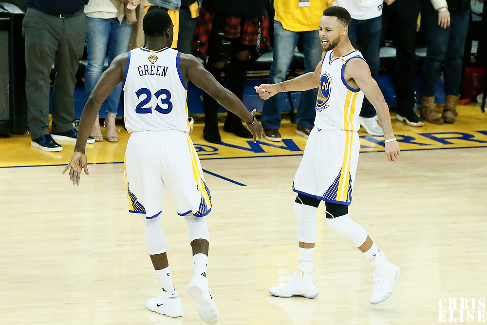 04 June 2017: Golden State Warriors forward Draymond Green (23) and Golden State Warriors guard Stephen Curry (30) celebrate during the Golden State Warriors 132-113 victory over the Cleveland Cavaliers, in game 2 of the 2017 NBA Finals, at the Oracle Arena, Oakland, California, USA.