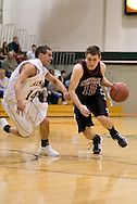 1/6/2006: Johnny Spevak of the Central Washington Wildcats tries to get past Junior guard Luke Cooper (14) of the UAA Seawolves as Anchorage goes on to beat the visiting Central Washington Wildcats, 80-60 at the Wells Fargo Sports Complex on the campus of UAA.<br />