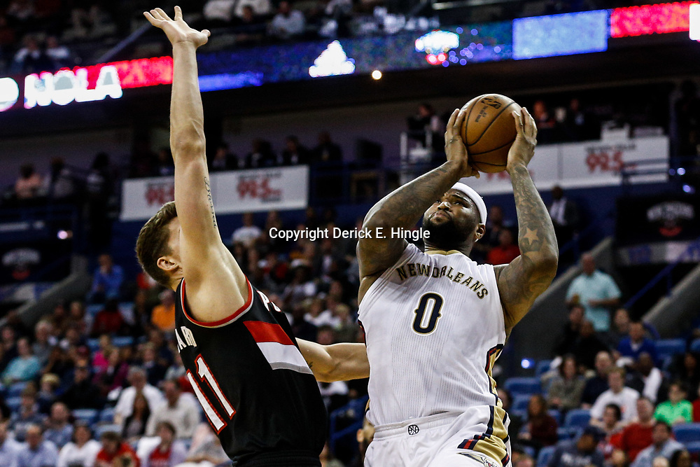 Mar 14, 2017; New Orleans, LA, USA; New Orleans Pelicans forward DeMarcus Cousins (0) shoots over Portland Trail Blazers forward Meyers Leonard (11) during the second quarter of a game at the Smoothie King Center. Mandatory Credit: Derick E. Hingle-USA TODAY Sports