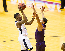 Feb 13, 2016; Morgantown, WV, USA; West Virginia Mountaineers guard Teyvon Myers (0) shoots over TCU Horned Frogs guard Lyrik Shreiner (0) during the first half at the WVU Coliseum. Mandatory Credit: Ben Queen-USA TODAY Sports
