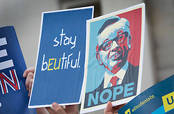 © Licensed to London News Pictures. 21/06/2016. London, UK. An activist holds a placard mocking Vote Leave campaigner Michael Gove (R) at a Remain campaign event in Trafalgar Square organised via Facebook. There are only two full days of campaigning ahead of the UK EU referendum taking place on Thirsday 23rd June, 2016. Photo credit: Peter Macdiarmid/LNP