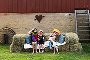 "Family, friends and guests are pictured in a ""help-your-self"" photo booth set up outside a barn following the wedding ceremony of Jessica VanEgeren and Andy Manis at a farm in Blanchardville, Wis., on Aug. 11, 2018. (Photo by Jeff Miller - www.jeffmillerphotography.com)"
