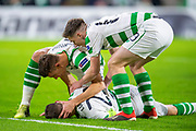 Kieran Tierney (#63) of Celtic FC and Filip Benkovic (#32) of Celtic FC tend to Mikael Lustig (#23) of Celtic FC after a clash of heads during the UEFA Europa League Group B match between Celtic FC and RB Salzburg at Celtic Park, Glasgow, Scotland on 13 December 2018.