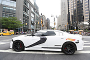 A Hot Wheels Star Wars First Order Stormtrooper Dodge vehicle, modeled after the new Hot Wheels line of Star Wars character cars, drives through Columbus Circle in New York, Friday, Sept. 4, 2015, to celebrate Force Friday.  (Photo by Diane Bondareff/Invision for Mattel/AP Images)