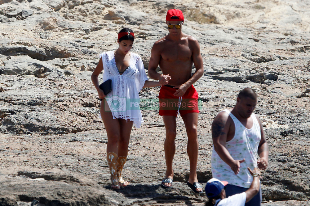 Cristiano Ronaldo and Giorgina Rodriguez go out together to eat at a restaurant in Formentera, enjoying a beach day<br /> <br />11 July 2017.<br /><br />Please byline: Vantagenews.com