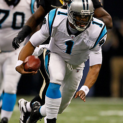 January 1, 2012; New Orleans, LA, USA; Carolina Panthers quarterback Cam Newton (1) runs with the ball against the New Orleans Saints during the first quarter of a game at the Mercedes-Benz Superdome. Mandatory Credit: Derick E. Hingle-US PRESSWIRE