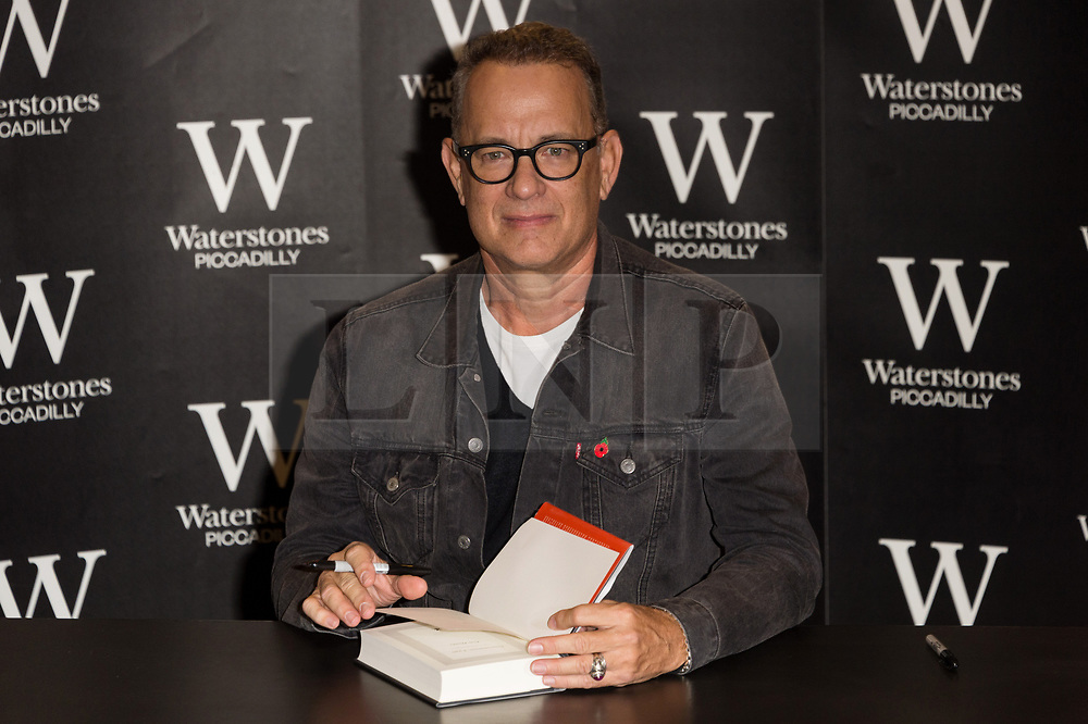 © Licensed to London News Pictures. 02/11/2017. London, UK.  Academy Award winning American actor TOM HANKSsigns copies of his first book, Uncommon Type: Some Stories, a collection of 17 short stories focusing around the theme of typewriters at Waterstone's Piccadilly. Photo credit: Ray Tang/LNP