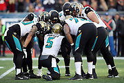 The Jacksonville Jaguars offense huddles and calls a play during the AFC Championship NFL playoff football game against the New England Patriots, Sunday, Jan. 21, 2018 in Foxborough, Mass. The Patriots won the game 24-20. (©Paul Anthony Spinelli)