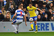 Jamie Shackleton (46) of Leeds United is challenged by Jack Bidwell (3) of Queens Park Rangers during the The FA Cup 3rd round match between Queens Park Rangers and Leeds United at the Loftus Road Stadium, London, England on 6 January 2019.
