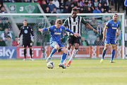 Jake Reeves midfielder for AFC Wimbledon (8) and Plymouth Argyle defender Jamille Matt  (19) battle for the ball during the Sky Bet League 2 match between Plymouth Argyle and AFC Wimbledon at Home Park, Plymouth, England on 9 April 2016. Photo by Stuart Butcher.