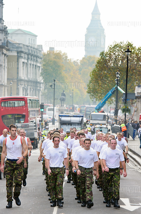20111112       Copyright image 2011©.Today, November 12th, Remembrance weekend, sees a team of over 100 former Royal Marines Commandos's cover a grueling 26 mile course across central London..Starting from Downing Street, the speedmarch hopes to raise over £1m for The Royal Marines Association by 2014, which is the 350th anniversary of the founding of the Royal Marines, raises funds for war wounded Royal Marines. Commando 999 is made up of former Commandos who are now servingin the UK's emergency services, this includes firefighters, ambulance staff and police officers...For photographic enquiries please call Anthony Upton 07973 830 517 or email info@anthonyupton.com .This image is copyright Anthony Upton 2011©..This image has been supplied by Anthony Upton and must be credited Anthony Upton. The author is asserting his full Moral rights in relation to the publication of this image. All rights reserved. Rights for onward transmission of any image or file is not granted or implied. Changing or deleting Copyright information is illegal as specified in the Copyright, Design and Patents Act 1988. If you are in any way unsure of your right to publish this image please contact Anthony Upton on +44(0)7973 830 517 or email: