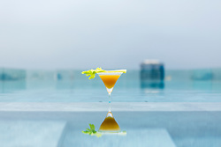 Cocktail Reflecting on Water on Roof Swimming Pool. Bangkok, Thailand