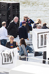 "© Licensed to London News Pictures. 15/06/2016. London, UK. Bob Geldof demonstrates on the ""Vote In' boat as the pro-Brexit campaign 'Fishermen for Leave', sail a flotilla of over 30 vessels up the Thames. The flotilla, including UKIP leader Nigel Farage, caused traffic issues in central London, as vessels travelled up the Thames for high tide and to coincide with the last Prime Minister's Questions before the EU referendum takes place on 23 June. Photo credit : Tom Nicholson/LNP"