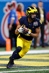 Michigan Wolverines wide receiver Ronnie Bell #8 returns a kick off during the Chick-fil-A Peach Bowl, Saturday, December 29, 2018, in Atlanta. ( Paul Abell via Abell Images for Chick-fil-A Peach Bowl)