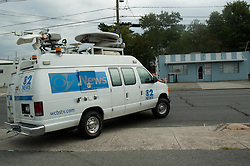 The CBS News television crew arrives across from the Tastee Sub SHop to cover the day's events.