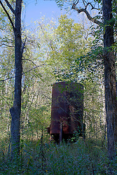 08 October 2013:   An old steel canister on stilts sits along the south road in Yellowwood State Forest<br /> <br /> Yellowwood State Forest was created on leased federal land in 1940.  It was later (1956) deeded to the state of Indiana.  More than 2000 vacant and eroded acres were planted with pine, black locust, black walnut, and red and white oak.  Yellowwood Lake is 133 acres and about 30 feet deep. This image was produced in part utilizing High Dynamic Range (HDR) processes. It should not be used editorially without being listed as an illustration or with a disclaimer. It may or may not be an accurate representation of the scene as originally photographed and the finished image is the creation of the photographer.