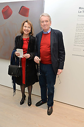 SIR CHRISTOPHER & LADY MEYER at the launch of a new exhibition 'Le Tarbouche' by French-Lebanese artist Mouna Rebeiz held at The Saatchi Gallery, Duke of York's HQ, King's Road, London on 26th February 2015.