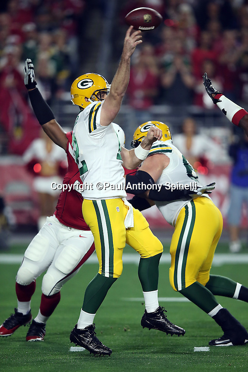 Green Bay Packers quarterback Aaron Rodgers (12) throws a third quarter pass during the NFL NFC Divisional round playoff football game against the Arizona Cardinals on Saturday, Jan. 16, 2016 in Glendale, Ariz. The Cardinals won the game in overtime 26-20. (©Paul Anthony Spinelli)
