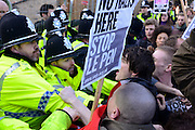 © Licensed to London News Pictures. 19/02/2013. Cambridge, UK Scuffles with police at an entrance to the building. Unite Against Fascism holds a demonstration and Rally today,19th February, outside the Cambridge Union debating society, against Marine Le Pen who has been invited to address the Union. Marine Le Pen is the President of the Front National, the third largest political party in France.  As a long-standing MEP, she has become a highly influential figure on the European right . Photo credit : Stephen Simpson/LNP
