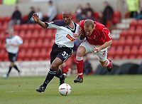 Photo. Leigh Quinnell.  Swindon Town v Walsall Coca Cola league one. 09/04/2005. Walsalls Julian Joachim battles with Swindons Sean O'Hanlon.
