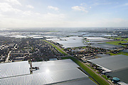 Nederland, Zuid-Holland, Gemeente Westland, 23-10-2013; Glazen stad, Kassengebied Westland. Omgeving 's-Gravenzande.<br /> Greenhouses area in the West of the Netherlands, the heart of the production of vegetables and fruit for export. Between The Hague and Rotterdam<br /> luchtfoto (toeslag op standard tarieven);<br /> aerial photo (additional fee required);<br /> copyright foto/photo Siebe Swart