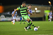 Forest Green Rovers Aarran Racine (21) and Cheltehham Town's Danny Whitehead  during the Gloucestershire Senior Cup match between Forest Green Rovers and Cheltenham Town at the New Lawn, Forest Green, United Kingdom on 20 September 2016. Photo by Shane Healey.