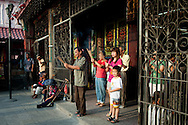 Malaysia, Georgetown. Worshippers in Kuang Yin Teng in the morning.