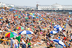 © Licensed to London News Pictures. 09/08/2020. Brighton, UK.Thousands of people take to the beach in Brighton And Hove on the hottest weekend of the year so far with temperatures going well in the 30C's in the South Coast. Photo credit: Hugo Michiels/LNP