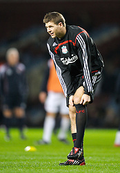 LONDON, ENGLAND - Wednesday, January 30, 2008: Liverpool's captain Steven Gerrard MBE pulls-up his socks as he warms-up before the Premiership match against West Ham United at Upton Park. (Photo by David Rawcliffe/Propaganda)