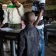Aonga, 5 years old is greeted by EVA staff.  Aonga is one of 120 children to be tested for HIV. Aonga's test came out negative. EVA provide HCT in three rural communities near Makurdi in Benue state. Benue state has got one of the highest HIV prevalence in Nigeria and EVA aim to target vulnerable children who would otherwise miss out of being tested for HIV and therefor not know their HIV statues.  Education As a Vaccine Against Aids (EVA) in Nigeria.
